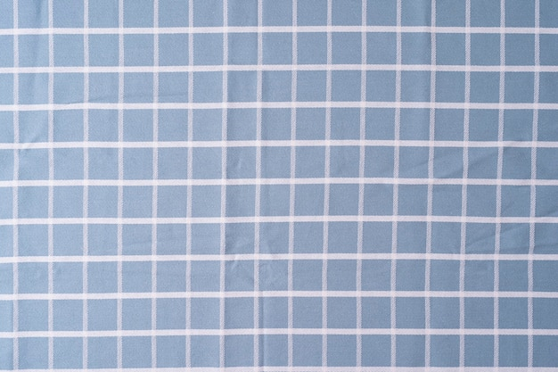 チェックシャツの生地のパターンと背景をクローズアップ生地の格子縞のテクスチャ布の背景青