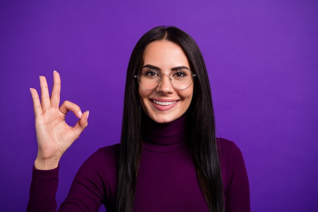Close up cheerful positive attractive woman smile toothy showing ok sign isolated bright color purple wall