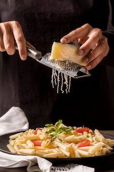 Close-up chef grating cheese