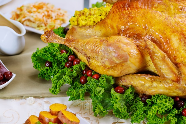 Close up of chicken, decorated with kale and cranberry for christmas dinner. holiday new year concept.