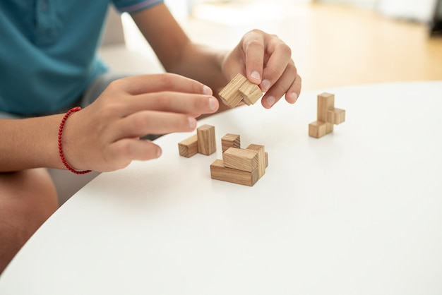 Close-up child playing jenga