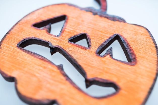 Close-up of childrens handicrafts for halloween. helloyin symbols - jack lantern, pumpkin, spider