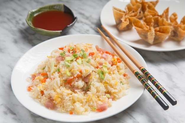 Close-up of chinese rice three delicacies and fried wanton.