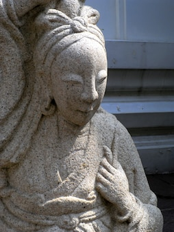 Close up chinese stone statue in wat pho, bangkok, thailand