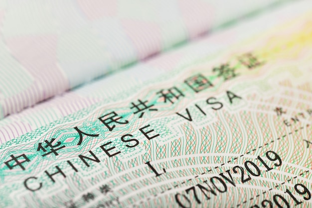 Close up of a chinese visa for travel in china background