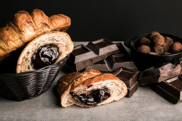 Close-up chocolate bar and croissants