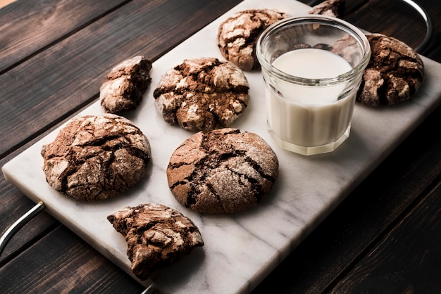 Close-up chocolate cookies with milk on the table