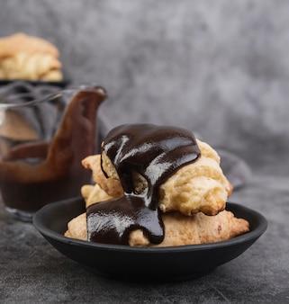 Close-up chocolate glazed croissants