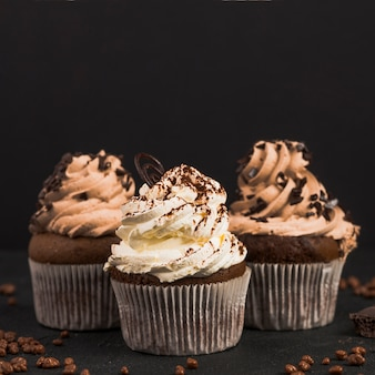 Close-up of chocolate muffins on dark background