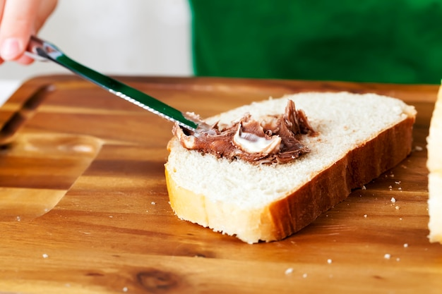 Close up on chocolate paste and a loaf of bread
