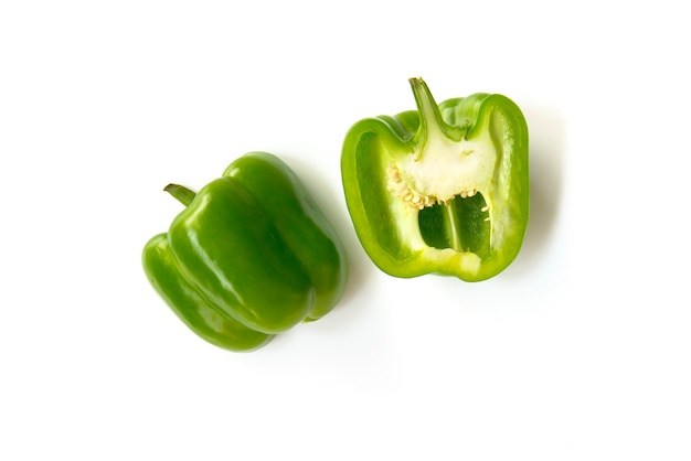Close up chopped and slice green bell peppers isolated on white background