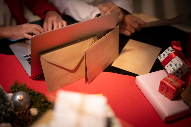 Close-up christmas envelopes and gifts