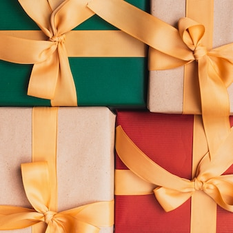 Close-up of christmas gifts with golden ribbon
