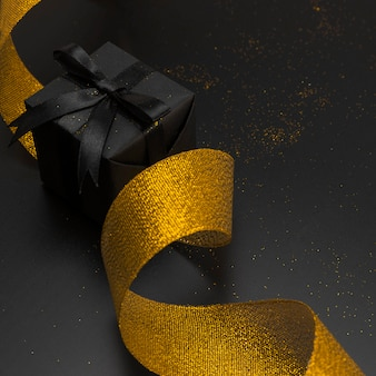 Close-up of christmas present with golden ribbon