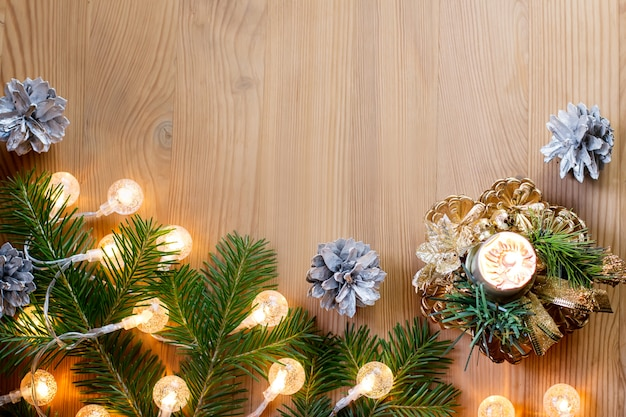 Close up of christmas tree with lights, candle and decorations. copy space, top view