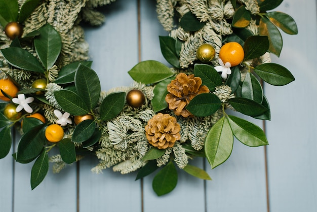 Close-up of a christmas wreath on a wall in a house