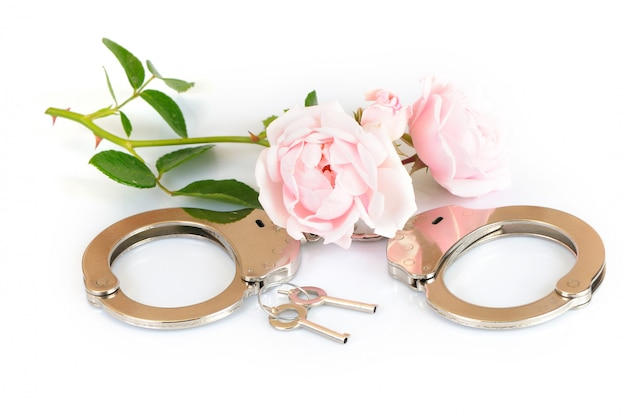 Close-up chrome handcuffs and keys