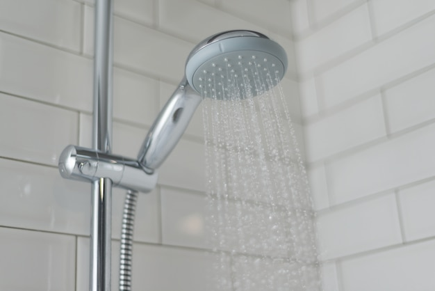 Close-up of chrome shower, faucet, in the bathroom