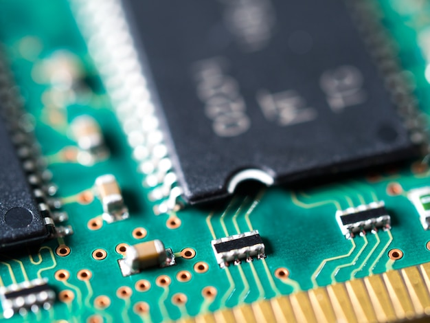 Close-up of circuit board with integrated circuits, resistors and capacitors.