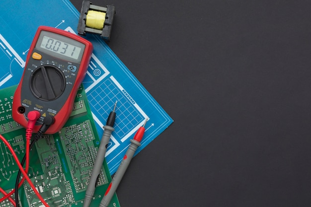 Close-up circuit board with multimeter