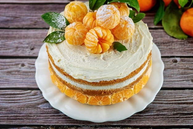 Close up of citrus pie with fresh mandarin and leaves