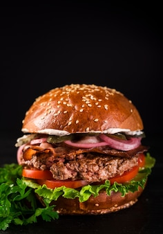 Close-up classic beef burger with lettuce