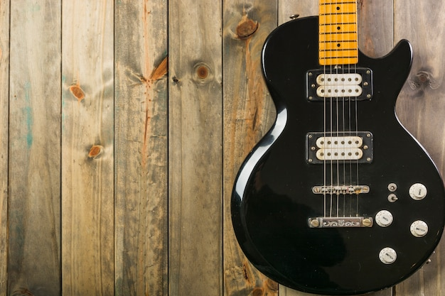 Close-up of classic electric guitar on wooden table