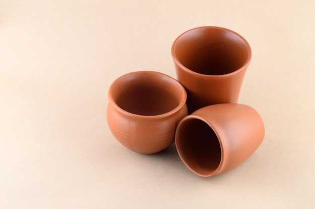 Close-up of clay pots on cream color