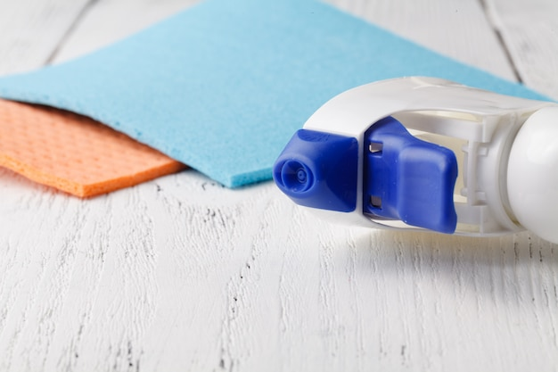 Close up of a cleaning spray bottle with clothes