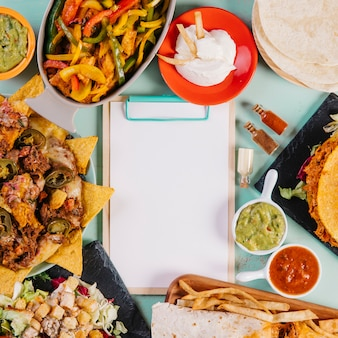Close-up clipboard and Mexican dishes