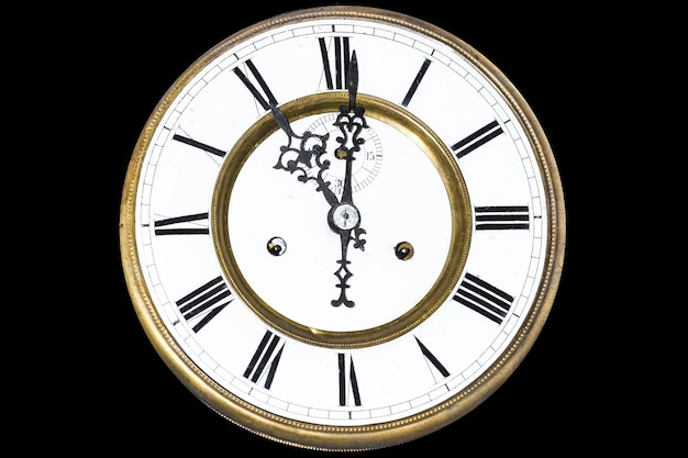 Close up on clock with roman numerals isolated