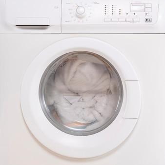 Close-up closed full washing machine Premium Photo