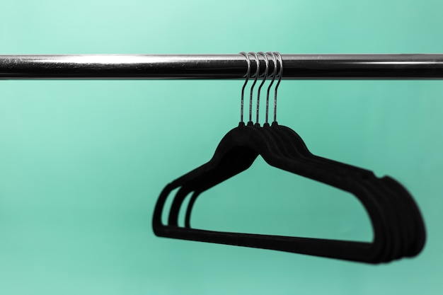 Close-up of clothes rack with black empty hangers