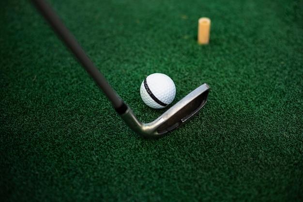 Close-up club striking golf ball