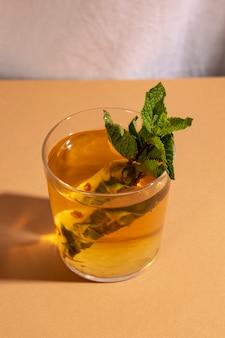 Close-up of cocktail drink on brown desk