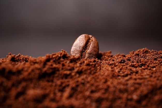 Close up of coffee beans at the mixed heap of roasted coffee