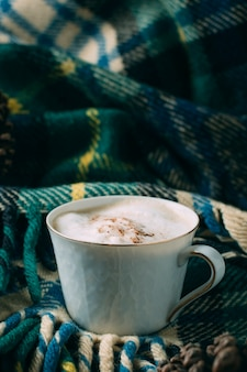 Close-up coffee cup with a blanket