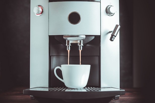 Close-up of coffee espresso pouring from machine