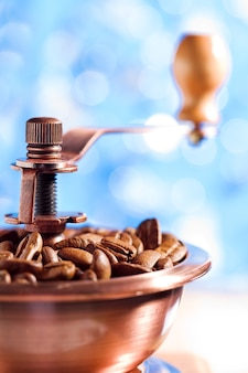 Close up of coffee grinder on the blurred background