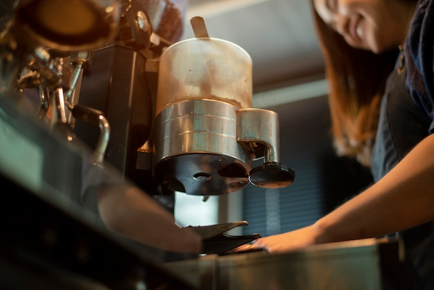 Close up of coffee machine is preparing coffee in coffee shop