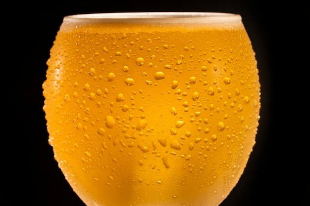Close up  of cold beer with drops and bubbles