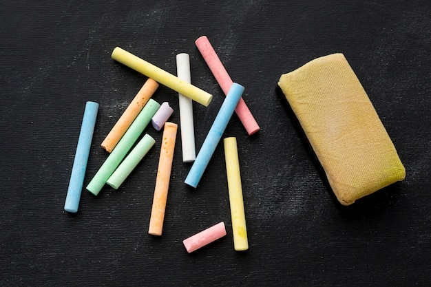 Close-up colored chalk with sponge