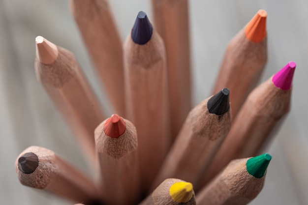 Close up of colored pencils for drawing on blurred surface