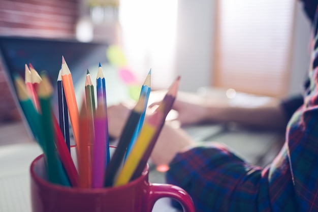 Close-up of colored pencils in mug
