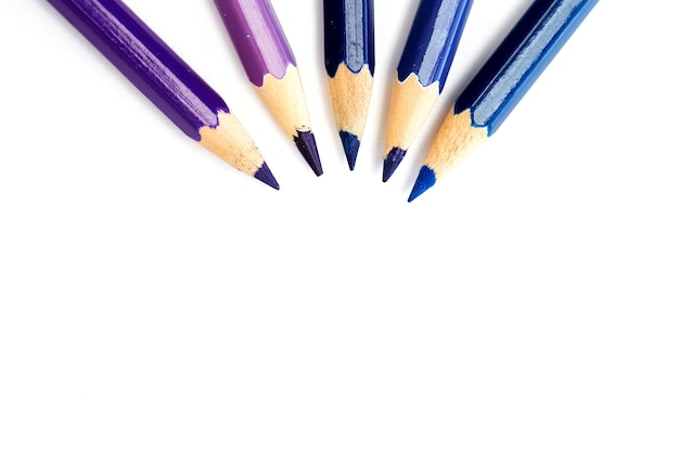 Close-up of colored pencils on white