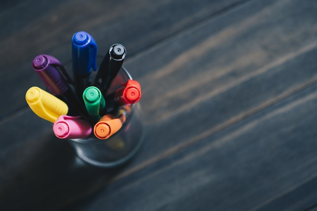 Close up of colored pens markers  in a cup