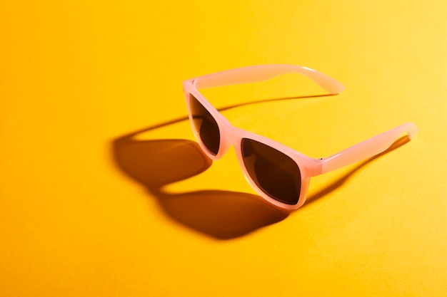 Close-up colored sunglasses with shadow