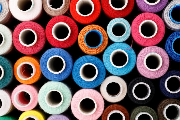 Close up of colored thread coils thread spools