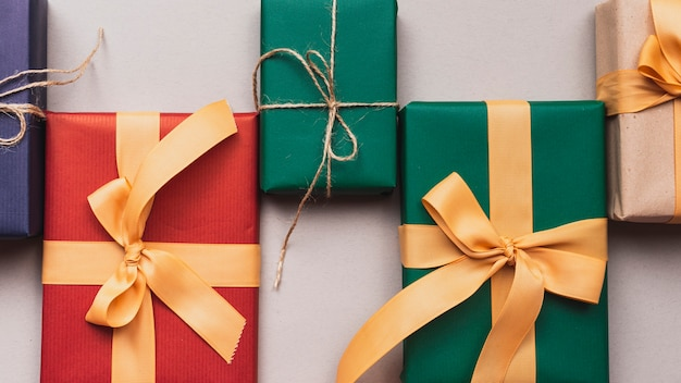 Close-up of colorful christmas gifts with ribbon