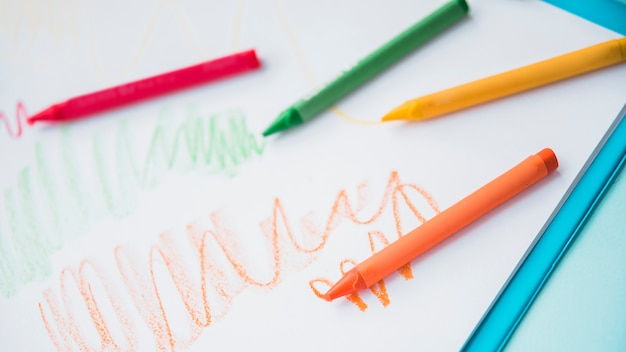 Close-up of colorful crayon on white paper